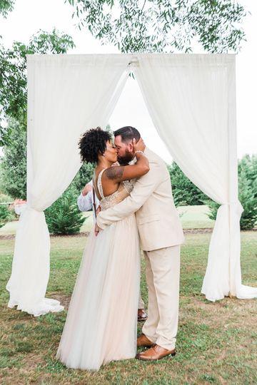 Newlyweds kissing - Crystal Artis Photography