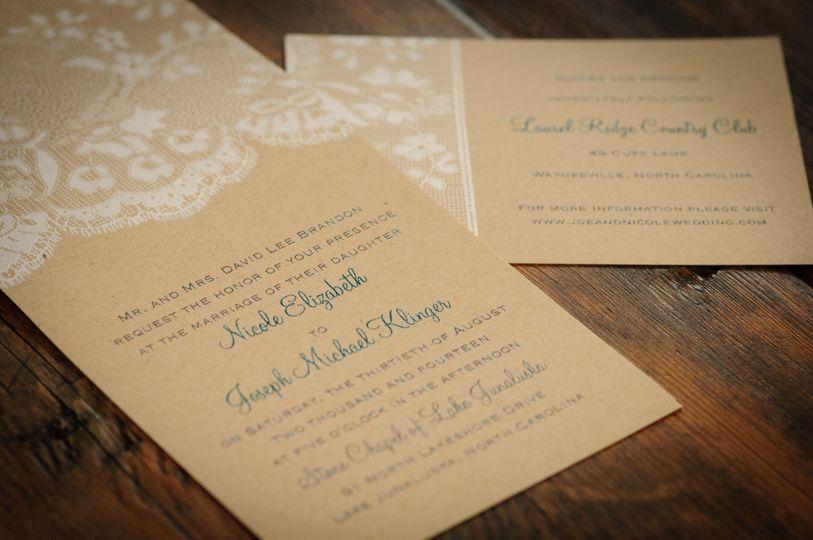 White details on tan invitation