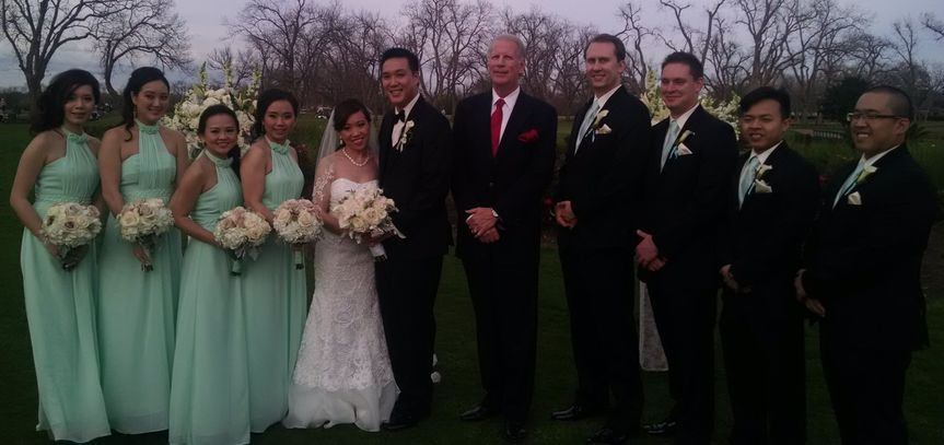 Newlywed and officiant with the guests