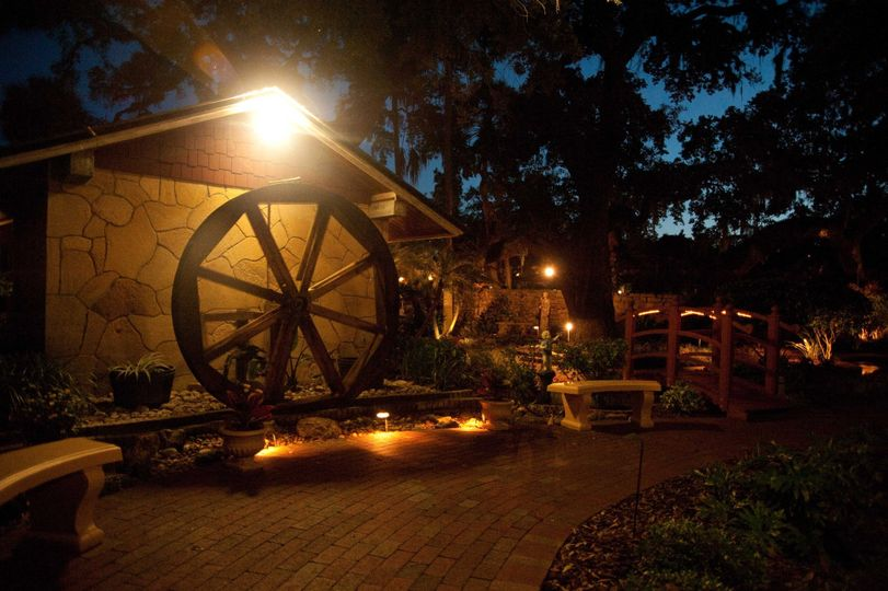 Water wheel and gardens at night