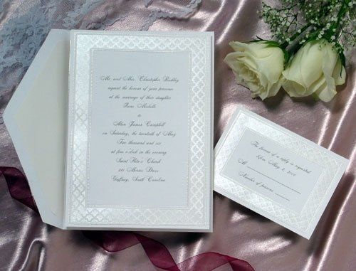 The delicate filigree border of this bright white invitation is soft yet elegant. The rich patterned...