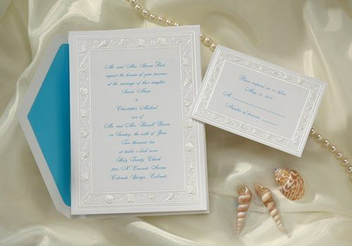 This bright white card is decorated with a pearl border of various sea shells setting the tone for...