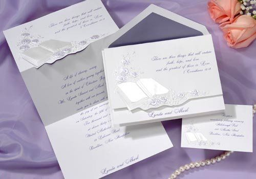 A beautiful purple Bible graces the front of this bright white invitation surrounded by roses. Your...
