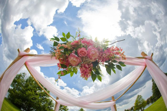 pink four post arbor pink floral wedding package