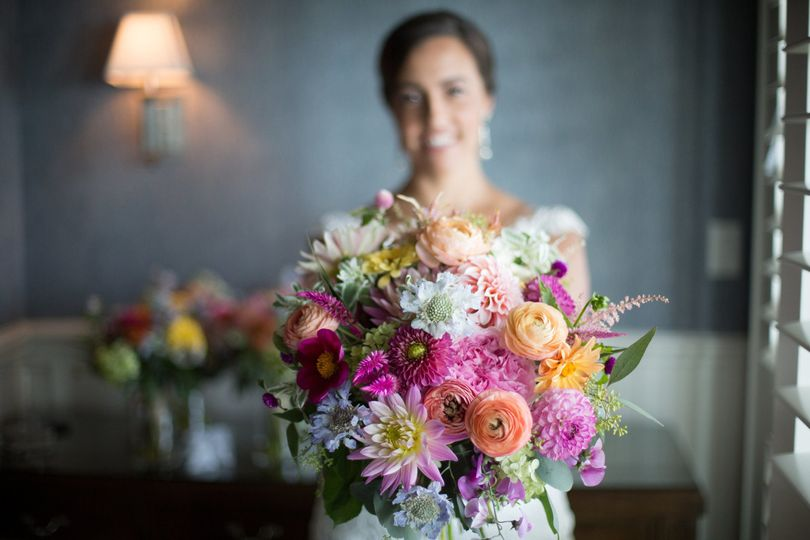 Colorful summer bride's bouquet with Dahlias at Madison Beach Hotel.