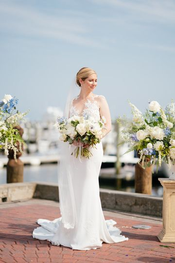 White and blue bride's bouquet with Peonies, Garden roses, Ranunculus, Anemones, Delphiniums at...