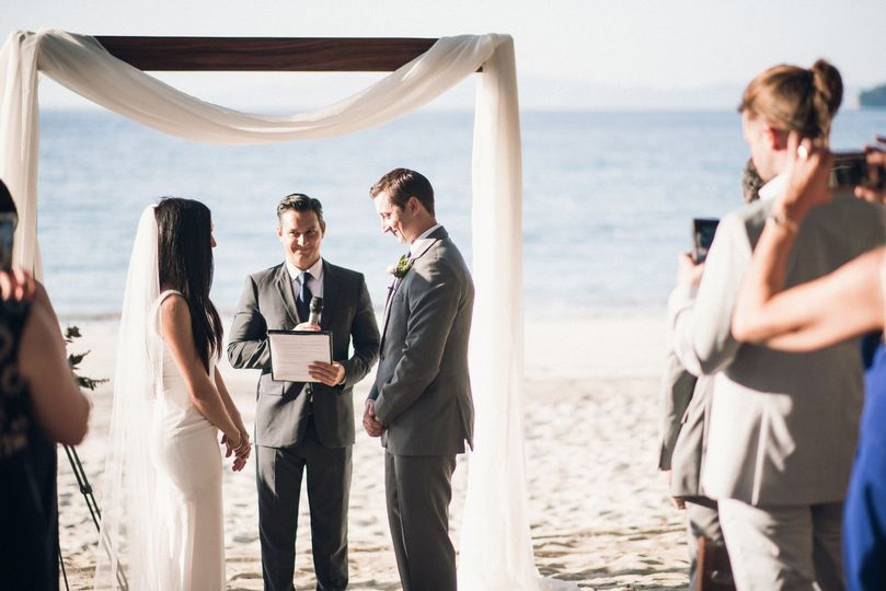 Exchanging vows by the ocean