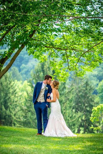 Newlyweds beneath tree