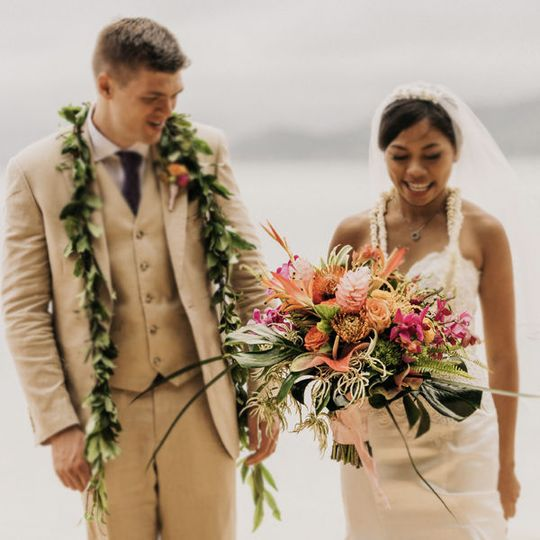 Couple with bouquet and plants
