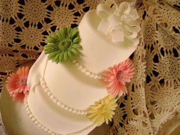 This cake is fondant with silk Gerbers.
