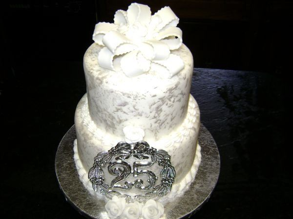 This cake is fondant with silver luster dust dabbed on for an added shine and design.