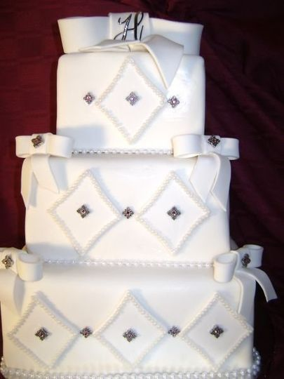 Another fondant cake done with fondant cut outs and real gems.