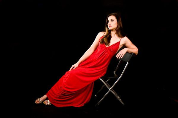 Photography courtesy of Laura Eaton. Draped red jersey dress designed by Darcy Law Couture