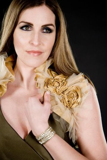 Gold rosette accessory courtesy of Bonzi, make-up by Beke Beau, and photograhy courtesy of Laura...