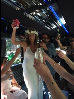 Bride toasting in New 2015 Party Bus in San Diego