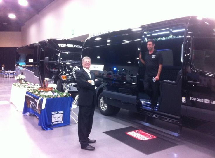 Russ in front of New 2015 Party Buses at the Bridal Bazaar in San Diego