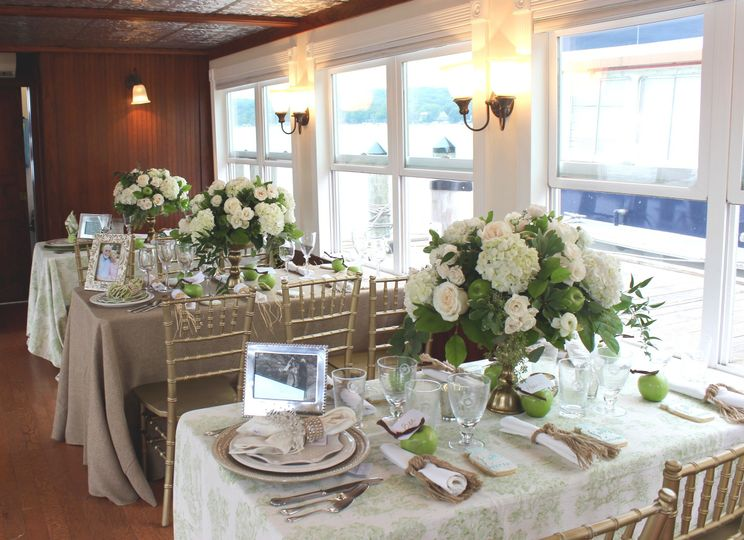 A classic wedding reception aboard the Duchess with green toile, burlap and gold accents.