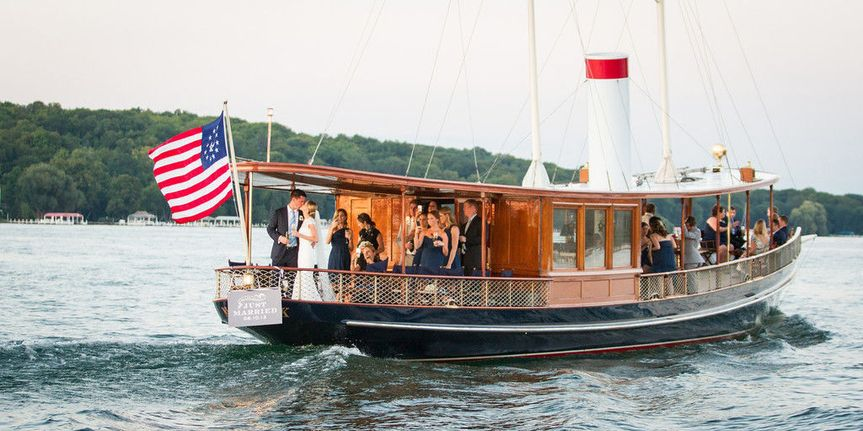 Water limo and wedding pictures aboard a classic yacht.