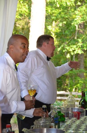 Catering by Design bartenders at a wedding at Shady Wagon Farm in New Hill, North Carolina on a...