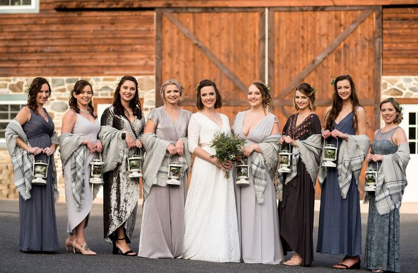 Bridesmaids in front of barn