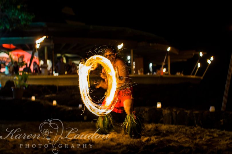 teeaoteturama fire dancer performs at a private wedding luau at Royal Kona © Karen Loudon