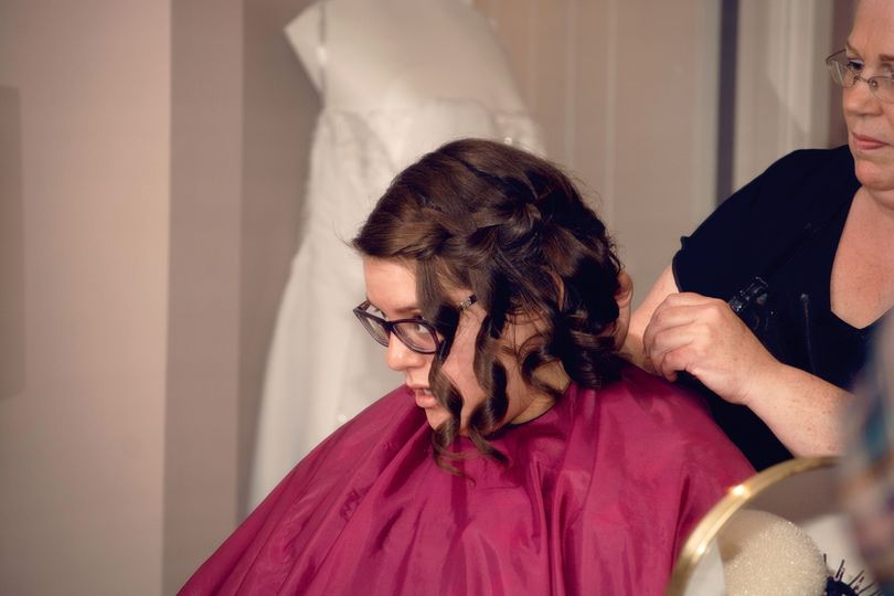 Maid of honor getting her hair