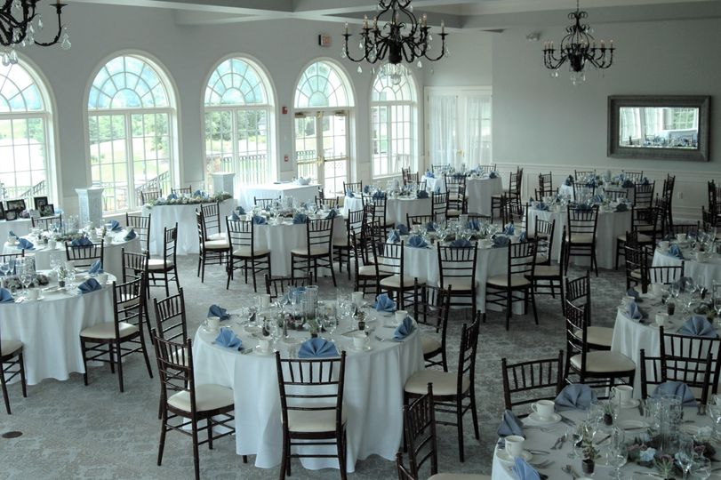 Reception tables with blue decor