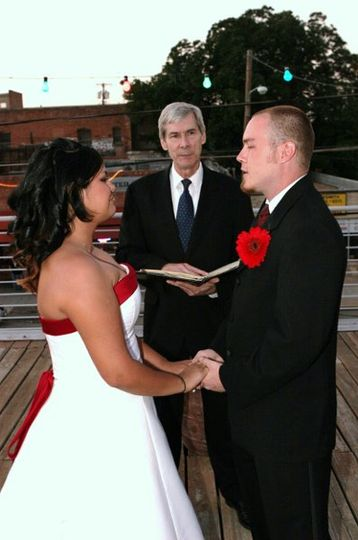 The bride and groom repeat vows that they chose prior to their wedding day.