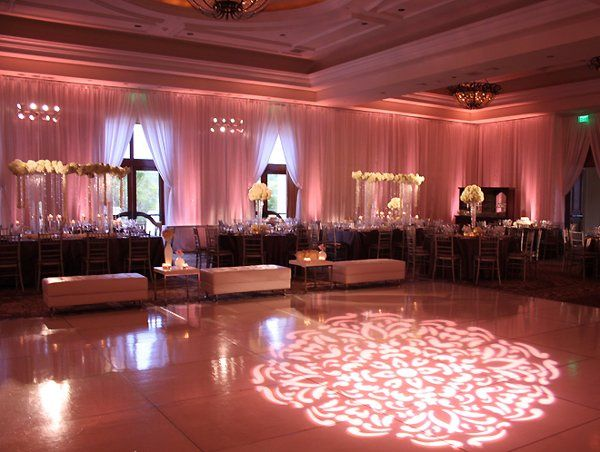 A defined pattern on the dance floor surrounded by lush satin draping will captivate your guests.