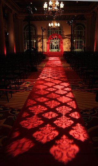 Damask Patterns projected on the aisle runner is a refreshing twist in giving your ceremony a...