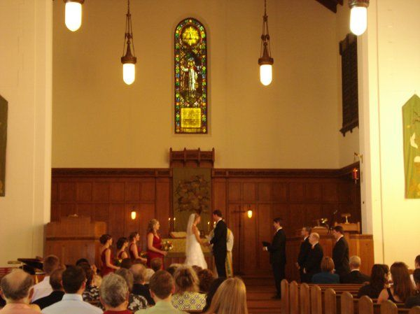 A view of the Sanctuary featuring our hanging lights and amazing stained glass. This wedding had...