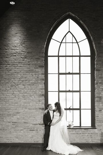 Couple in front of Gothic arch