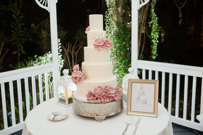 Five tier cake with pink flowers