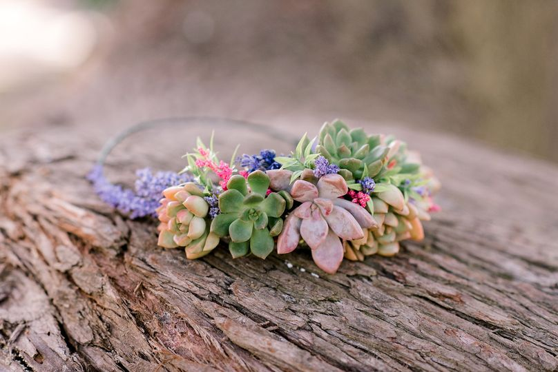 Succulents make for a sturdy bridal crown. This one includes artificial flowers for pops of pink and...