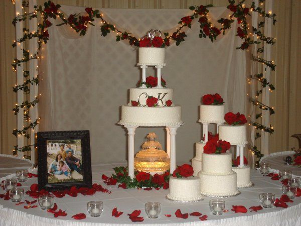 Assemetrical wedding set up with family photos and lots of beautiful red roses at the Oswego...