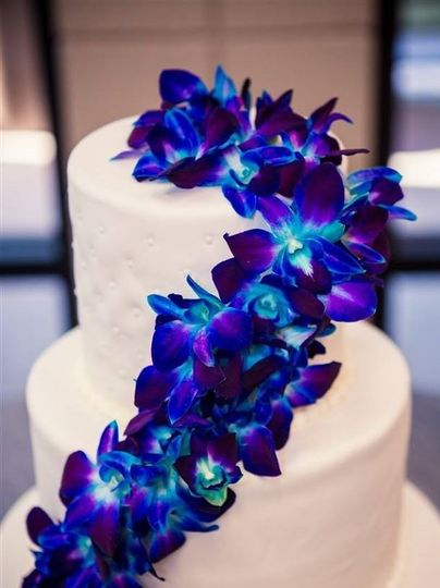 Blue orchids on cake