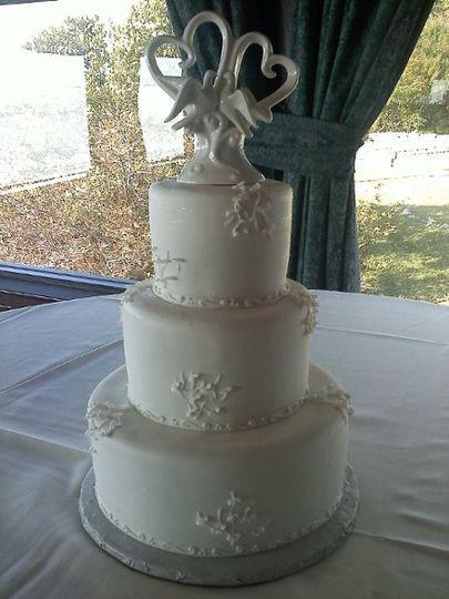 Wedding cake with white figurine