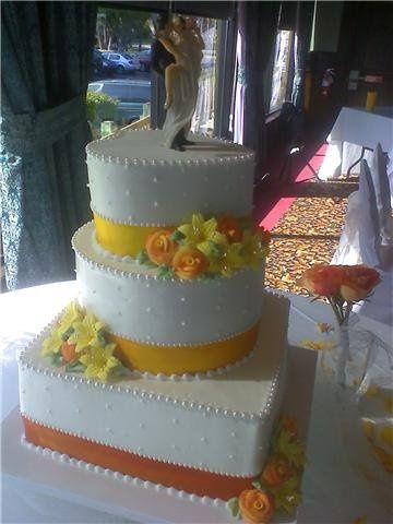 Wedding cake with a touch of yellow and orange