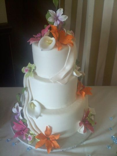 Wedding cake with pink and orange flowers