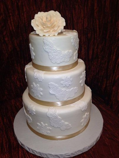 Wedding cake with gold ribbon