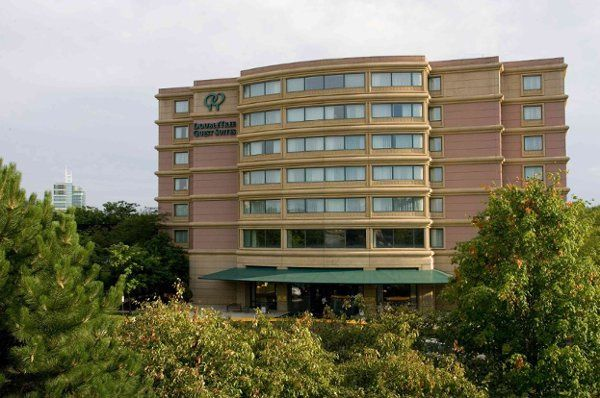 Exterior view of the Doubletree Guest Suites Hotel. 247 All Suite accommodations. Ride the Elevator...