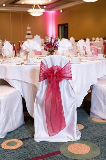 Our Hotel Grand Ballroom packages include uplighting and chair covers and ties!