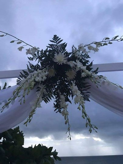 Wedding officiant arch decor