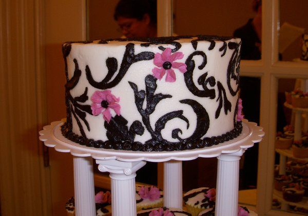 Ceremonial cake topper (they used this for the cake cutting). Vanilla cake with buttercream icing....