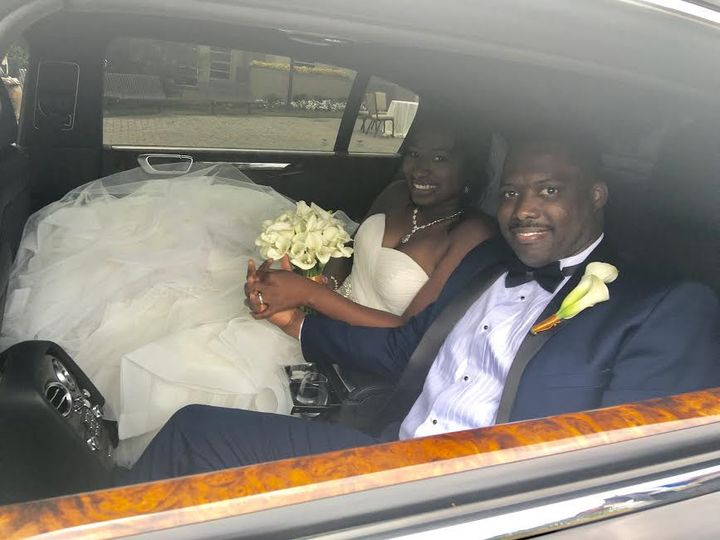 Bride and groom in their car