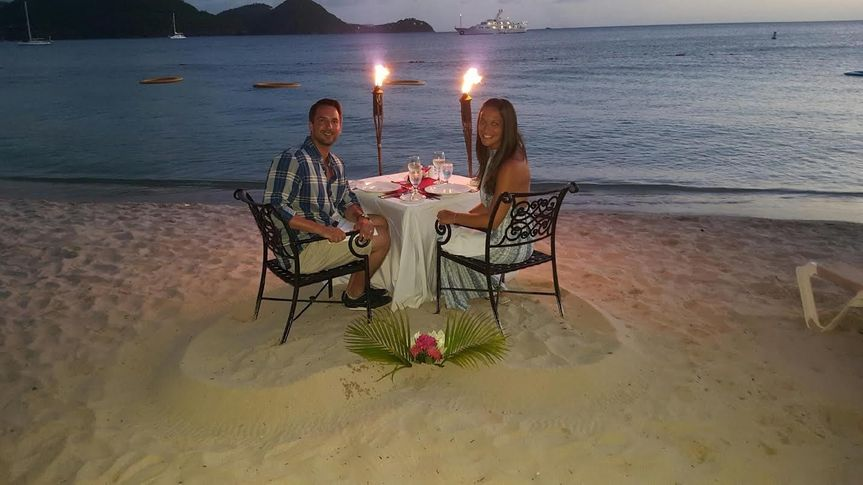 Romantic dinner setup at the beach