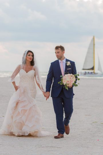 Beach wedding with sailboat