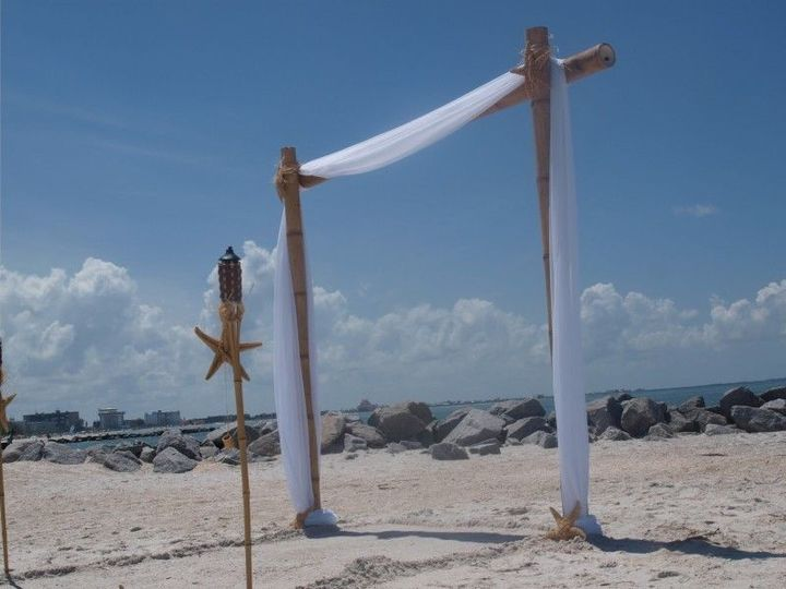 3 Sided Bamboo Arch rental . Starts at $150.00 . Tiki torches  extra . Package prices available....