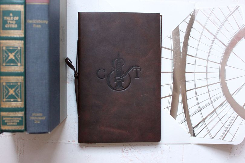 Leather envelope with initials logo