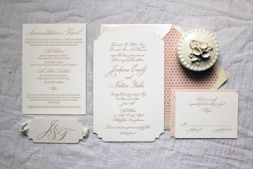 Dusty pink envelope lining with gold text